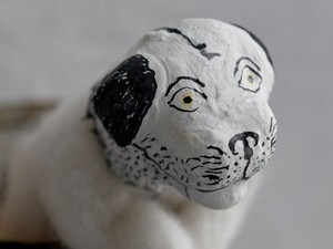 Felted dog with head made from plaster