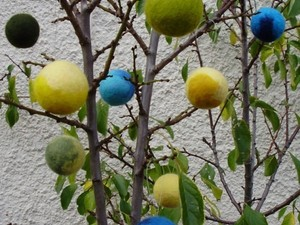 Balls hanging from the tree made out of felt