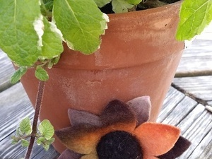 Flower resting on plant pot, made out of felt