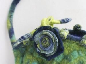 Green felt handbag with flower design