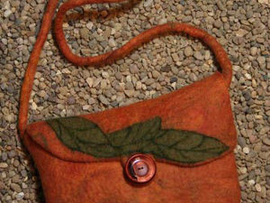 Orange Bag With Leaf Decoration