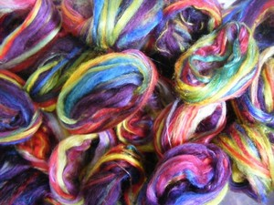 Colourful balls of dyed wool tops