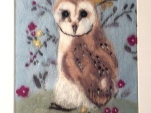Felted owl in field