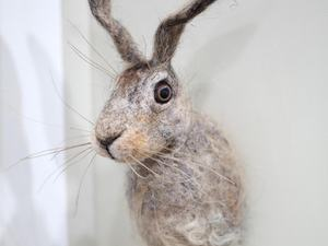 Felted hare wall hanging