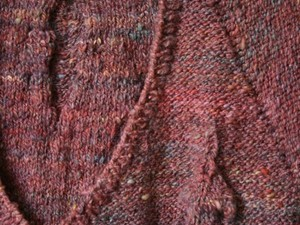 Burgundy jumper made out of yarn