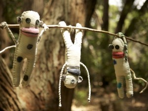 Hanging felted aliens