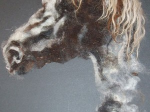 Horse head shot painted using wool