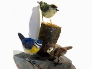 Felted birds on wood block