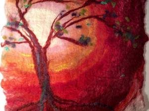 Felted tree design blowing in the wind