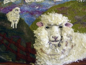 Fluffy felted sheep in the field