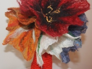 Felted flowers situated in wool vase