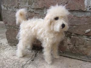 Fluffy white felted dog