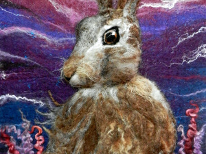 Felted hare in field