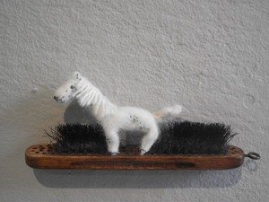 White felted horse