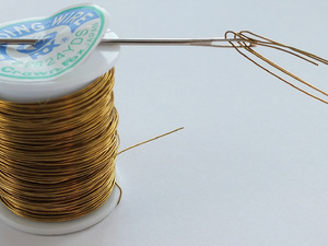 9. Thread Wire Through Large Needle To Pass Through Snowball
