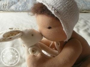 Felted doll kissing rabbit