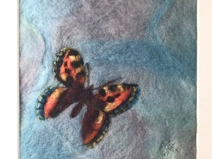 Felted butterfly flying in the sky
