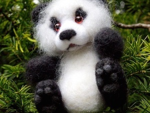 Felted panda in a tree