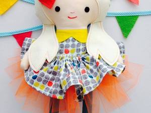 Felted doll with tutu design