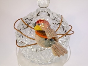 Felted red robin on glass