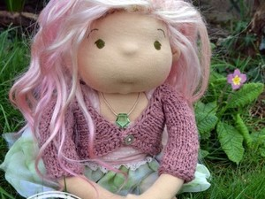 Needle felted doll with wool clothing