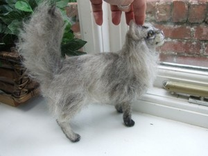 Felted cat being stroked