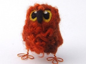 Orange owl made out of fluffy fleece