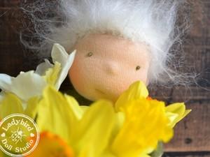 Felt doll finding behind flower