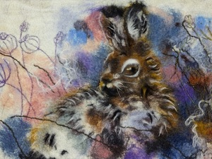 Fluffy felted hare in the woods