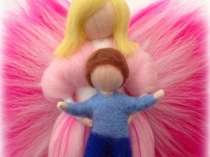 Felted fairy holding child