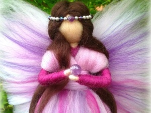 Pink and purple felted fairy holding glass ball