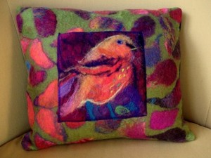 Multi-coloured cushion created using felt