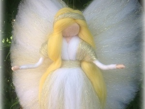 White guardian angel made out of felt