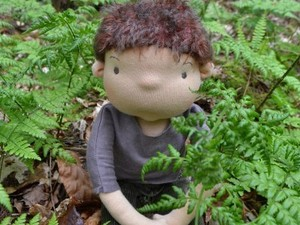 Felted boy sitting in the woods