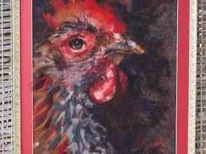 Close up of feathered cockerel using felt