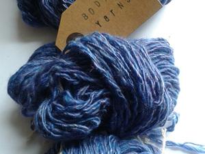 Three balls of blue yarn
