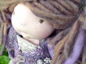 Felt doll with wool hair