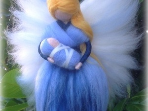 Blue felted fairy holding baby