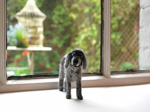 Grey and white felted dog made out of felt