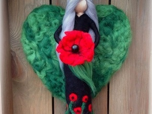 Felted fairy holding poppy
