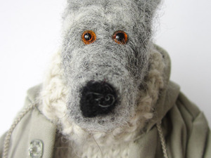 Felt dog with coat and scarf