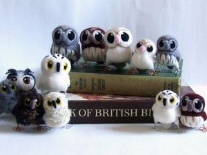 Various owls made out of fleece