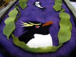 Close up of felted penguin table runner