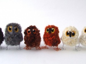 Range of different coloured fleece owls
