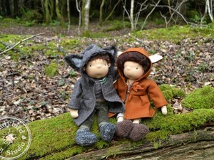 Boy and girl felted dolls in the wood