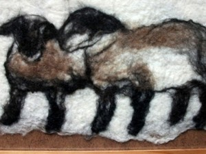 Sheep in the snow made out of felt