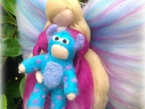 Felted angel holding teddy