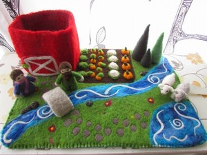 Felted design of a river and garden