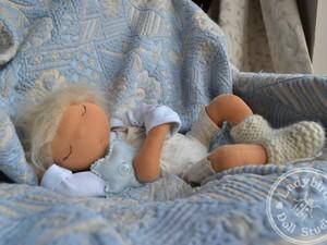 Sleeping doll on sofa