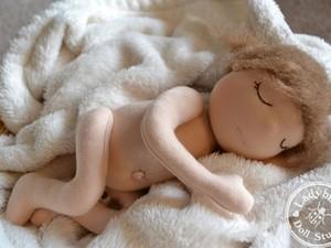 Sleeping felted doll